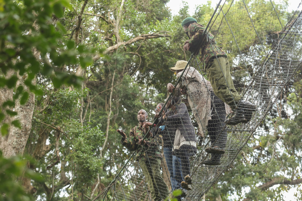 Ibrahim Maina,a guard at Ngare Ndare forest takes travellers through Ngare Ndare Canopy walkway