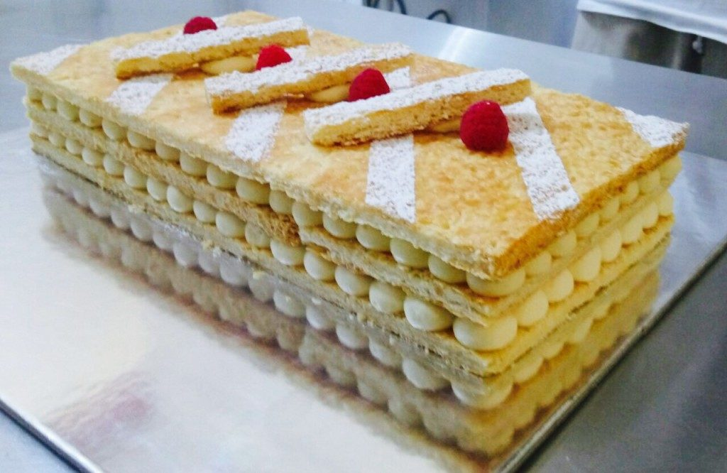 Translates to 'a thousand sheets', made of razor-thin pastry layers